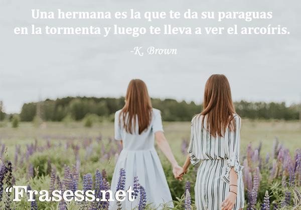 Frases para una hermana especial - Una hermana es la que te da su paraguas en la tormenta y luego te lleva a ver el arcoíris.